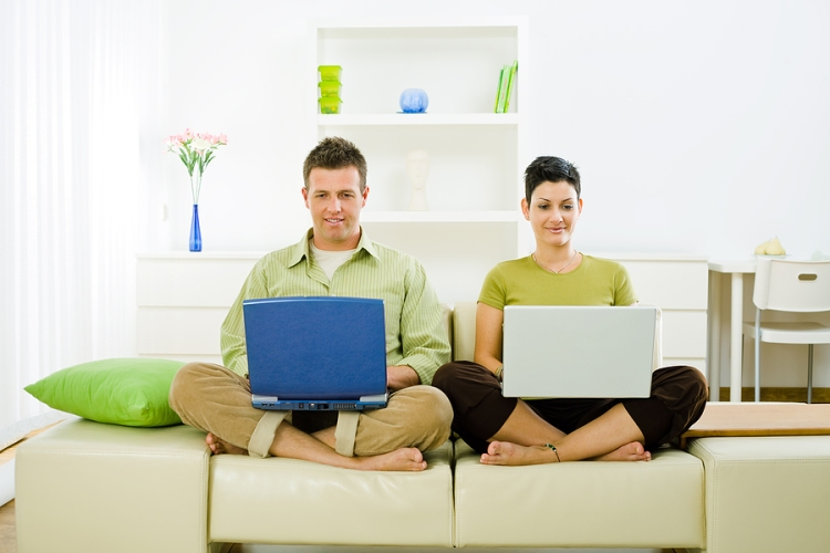 bigstock_Couple_Working_On_Laptop_3989992